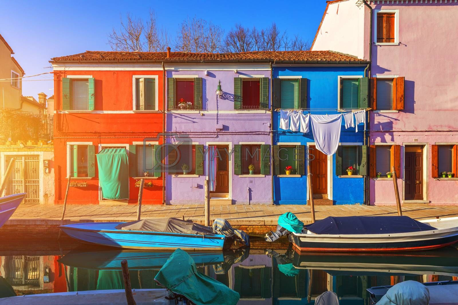 Lovely house facade and colorful walls in Burano, Venice. Burano island canal, colorful houses and boats, Venice landmark, Italy. Europe