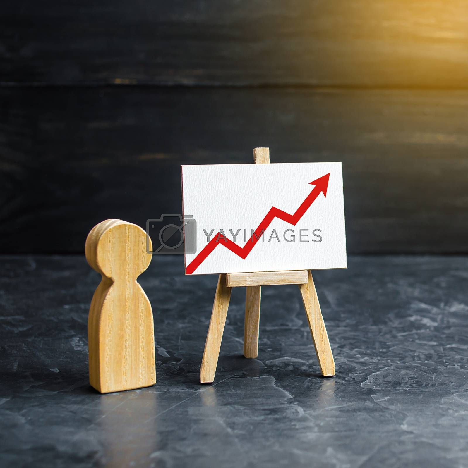 A person is standing near a chart with a red up arrow. Financial success and achievement. Business report and idea. Summarizing. Analysis and market research. Education in economics. Statistical data by iLixe48