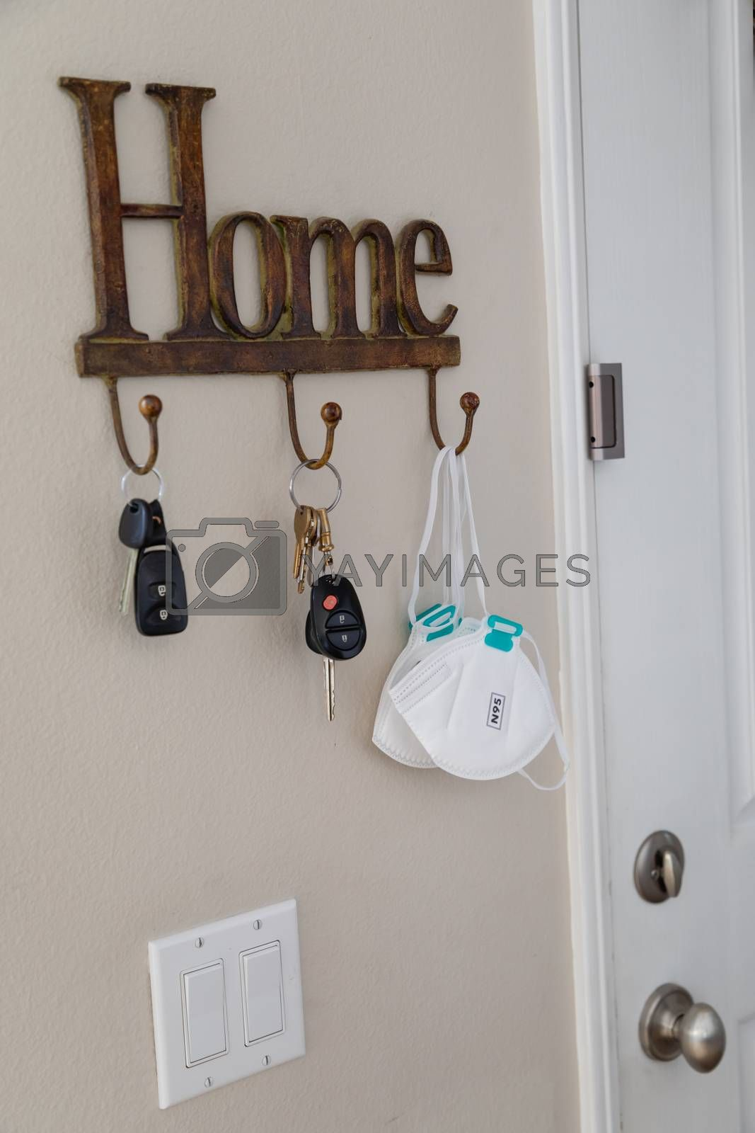 Home Key Hanger Rack Next to Door With Keys and Medical Face Mask During Coronavirus Pandemic.
