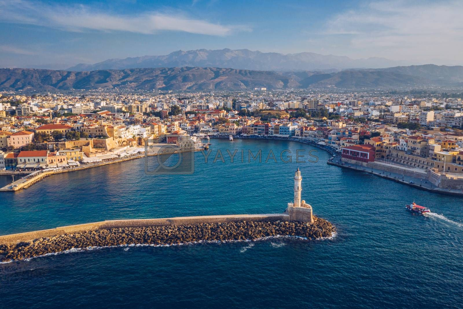 Picturesque old port of Chania. Landmarks of Crete island. Greece. Aerial view of the beautiful city of Chania with it's old harbor and the famous lighthouse, Crete, Greece.