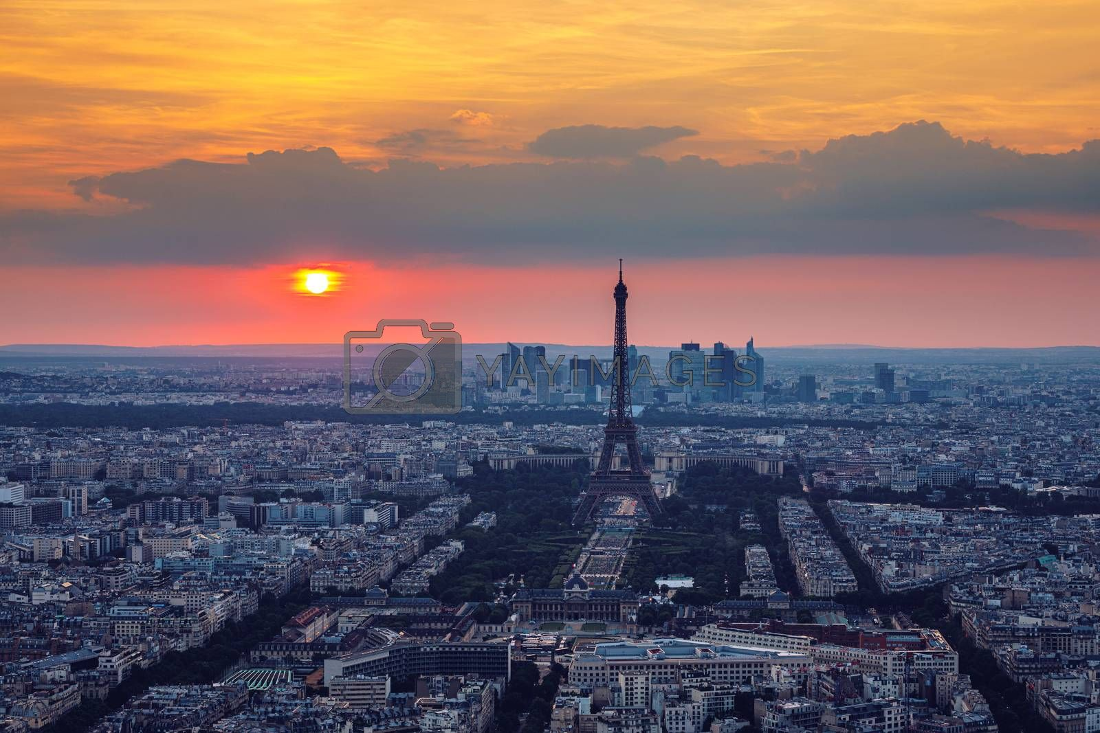 View of Paris with Eiffel Tower from Montparnasse building. Eiffel tower view from Montparnasse at sunset, view of the Eiffel Tower and La Defense district in Paris, France.