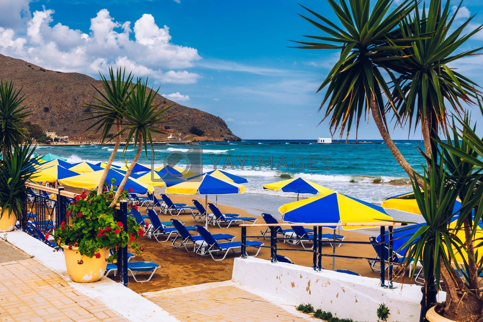View of sunbeds awaiting tourists at the Greek island resort of Georgioupolis on Crete north coast. Georgioupoli is a resort village and former municipality in the Chania regional unit, Crete, Greece.