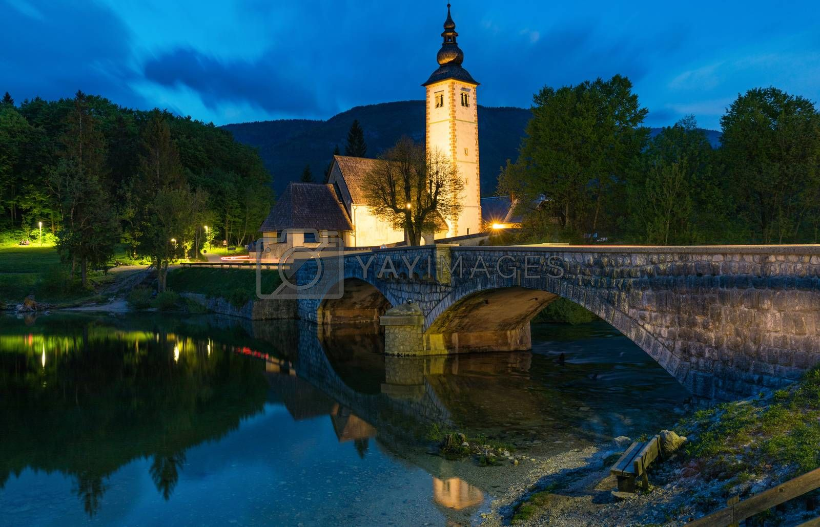 Church of Sv. John the Baptist and a bridge by the Bohinj lake in night, Slovenia. Church of St John the Baptist with bridge. Triglav National Park, Julian Alps, Slovenia, Europe
