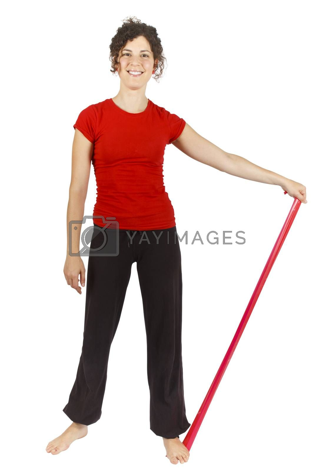 Young woman doing some exercise with an elastic ribbon.