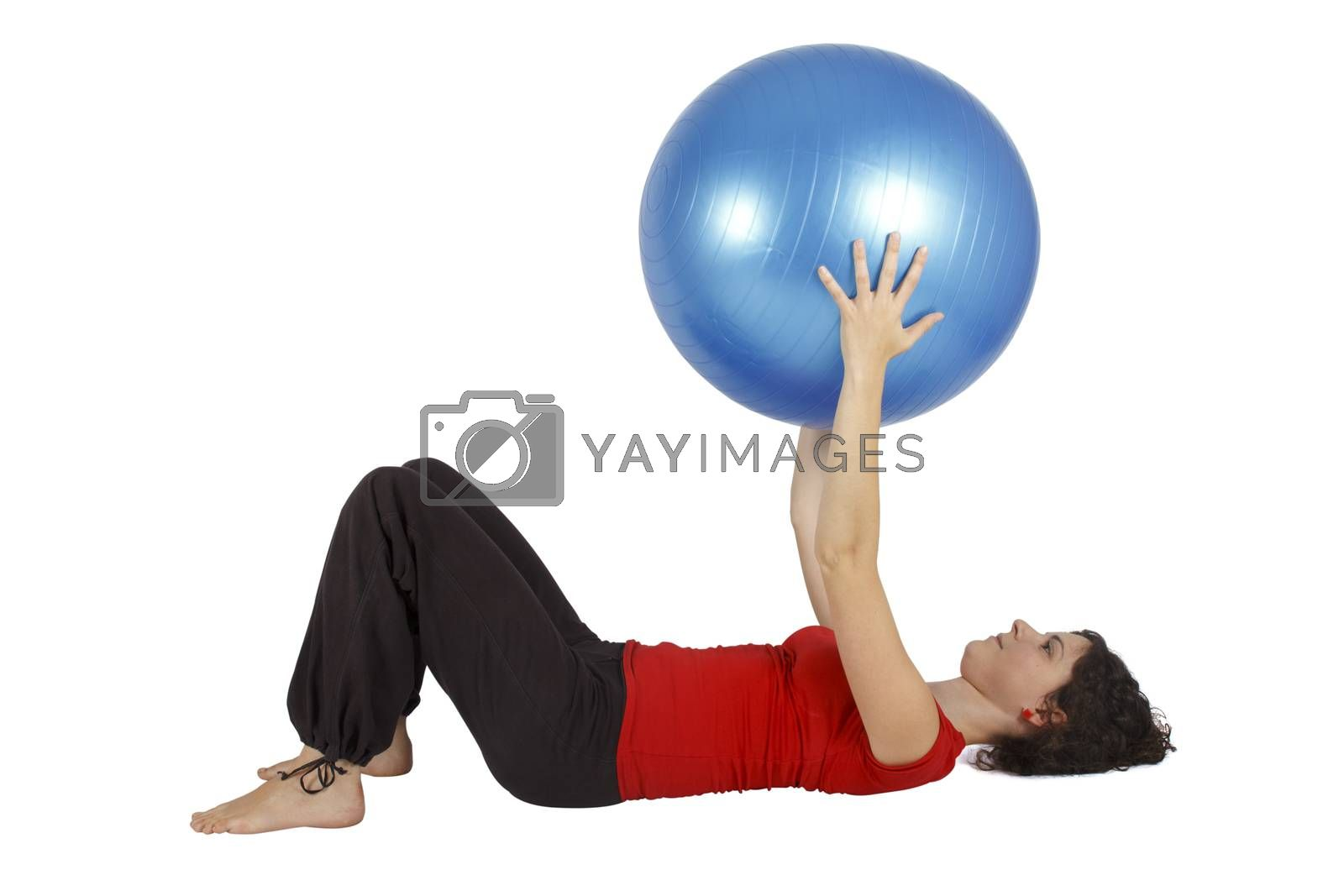 Young woman holding a blue yoga ball.