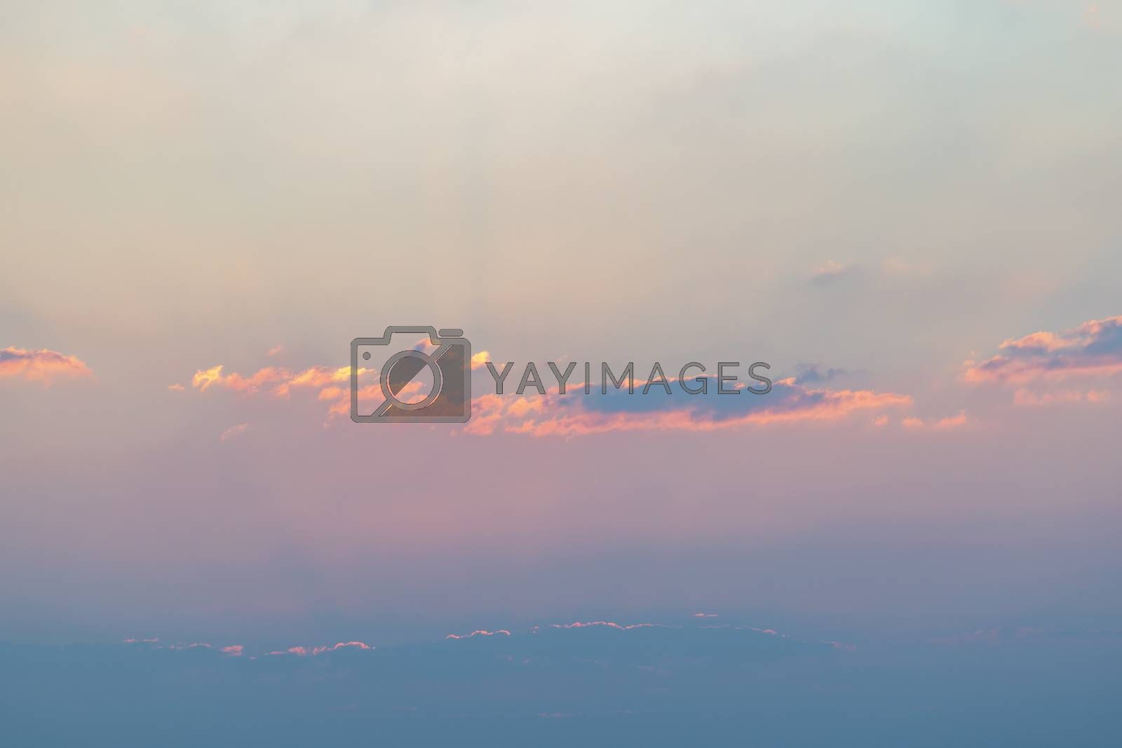 Colorful clouds in the sky for background. Pastel colors sky with yellow, orange and black clouds.