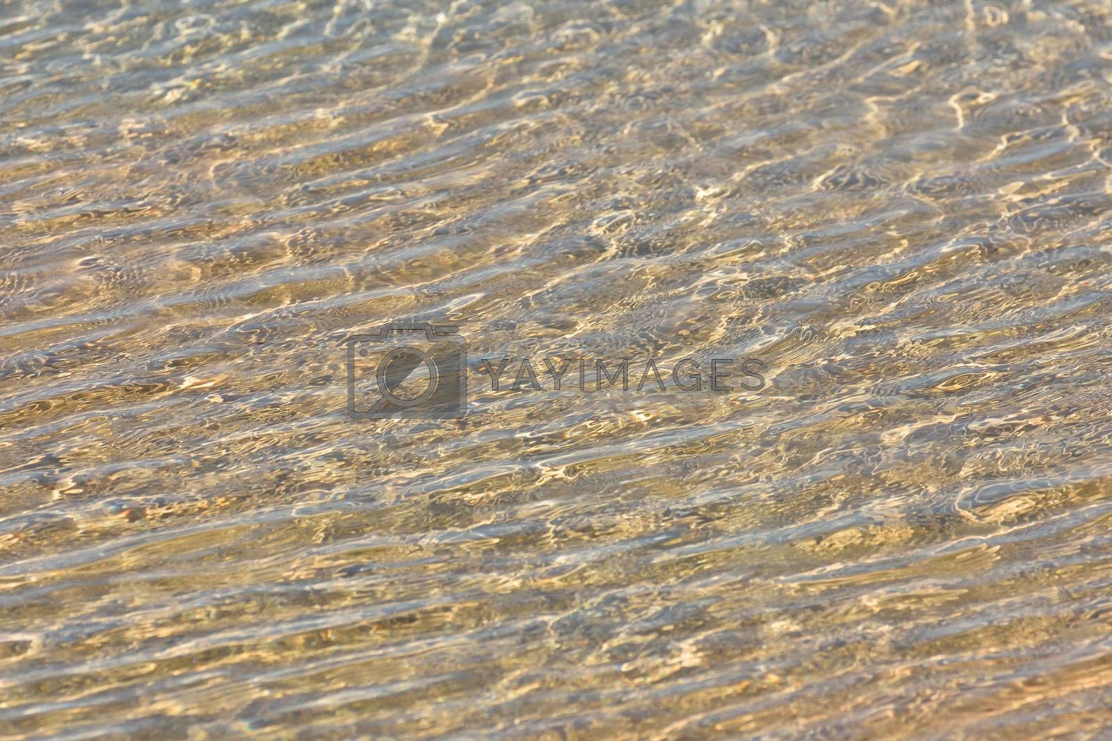 Natural clear beach sea water textured ripples in coastal pool, Mossel Bay, South Africa