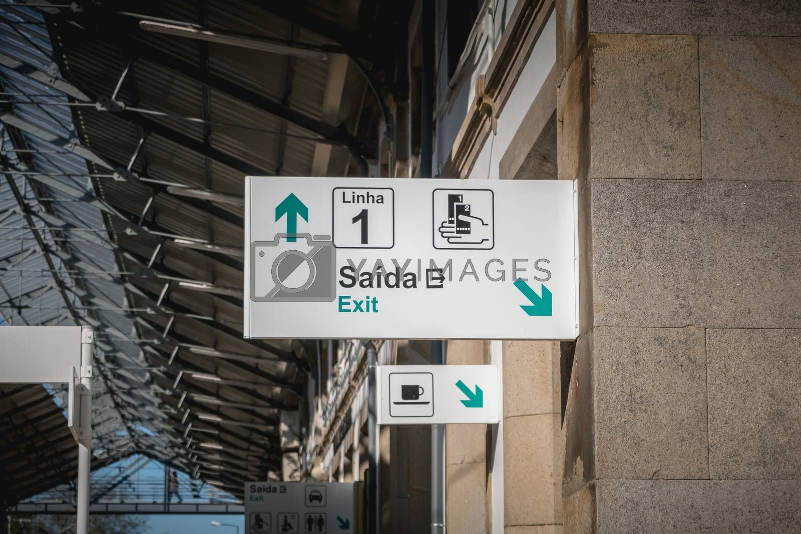 Viana do Castelo, Portugal - May 10, 2018: sign indicating the exit and line 1 in the train station on a spring day