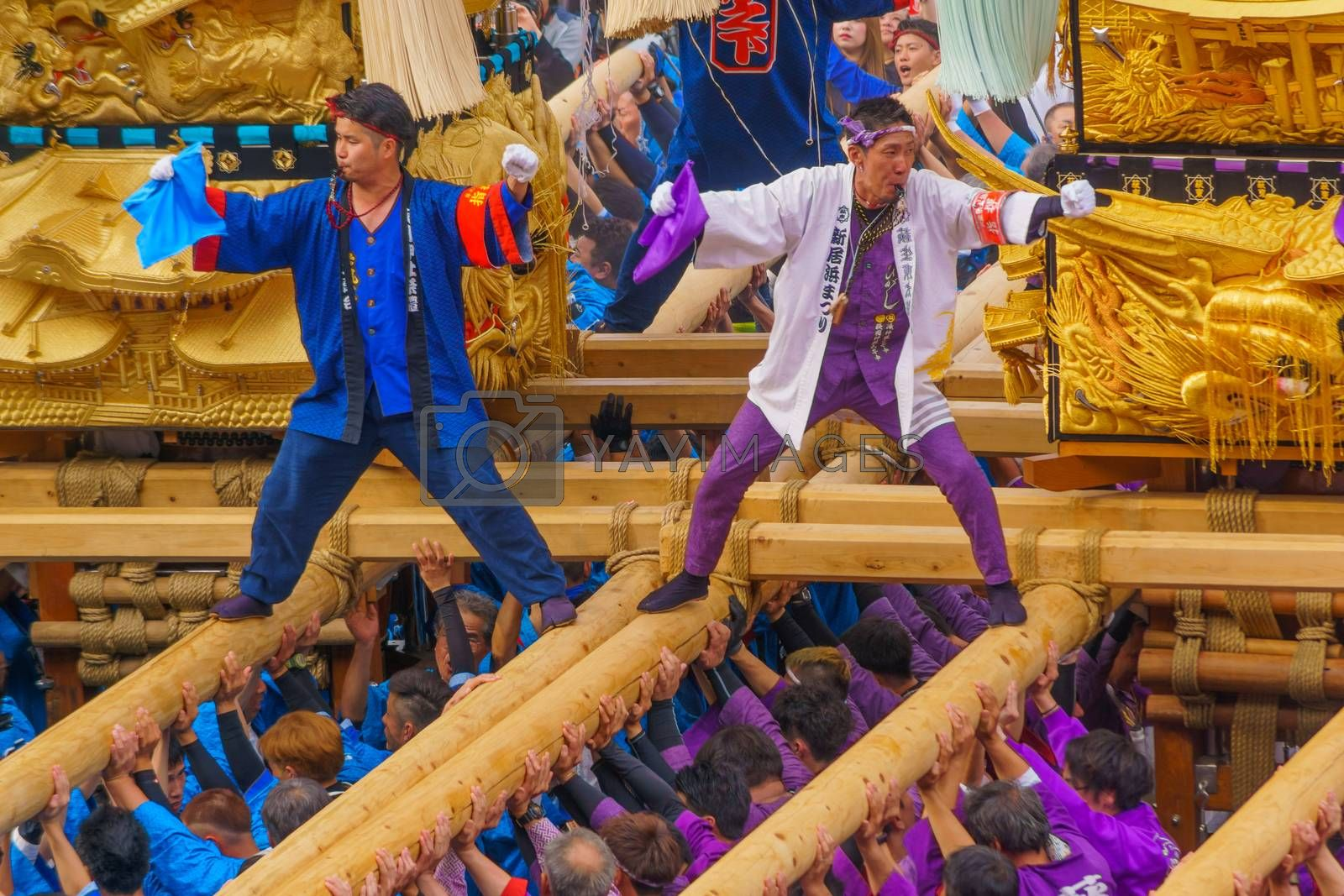 Niihama, Japan - October 17, 2019: Men in traditional clothing lifting a taikodai drum float, as part of the Niihama Taiko Festival, Ehime, Shikoku Island, Japan
