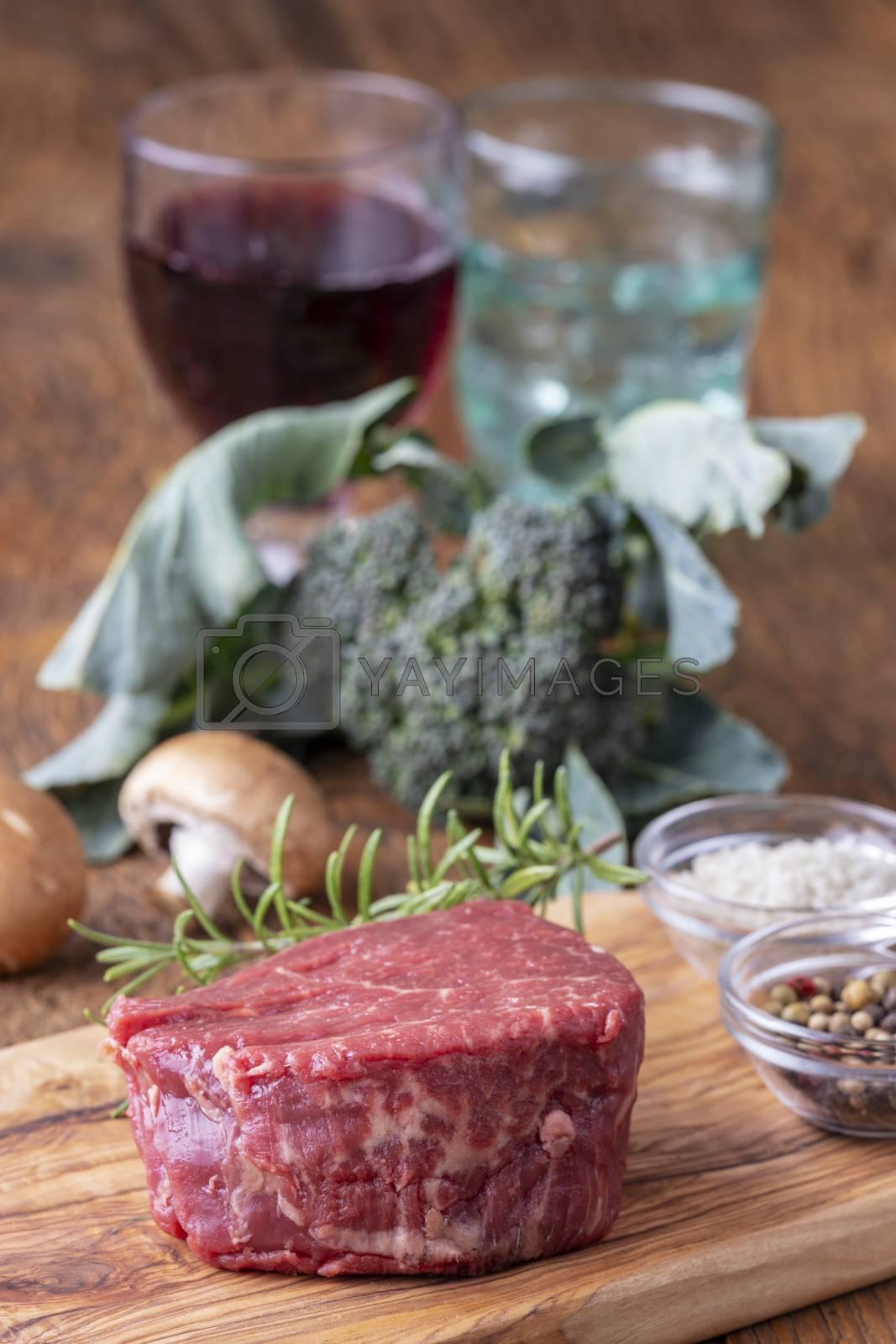 raw steak with broccoli on wood
