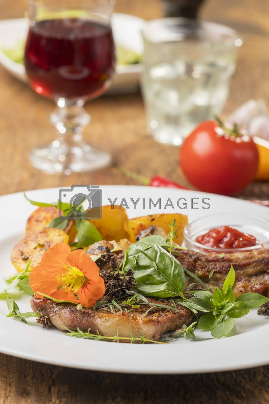 grilled veal cutlet with a nasturtium flower