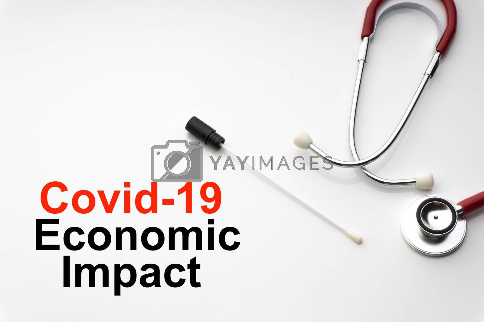 COVID-19 ECONOMIC IMPACT text with stethoscope and medical swab on white background. Covid or Coronavirus Concept