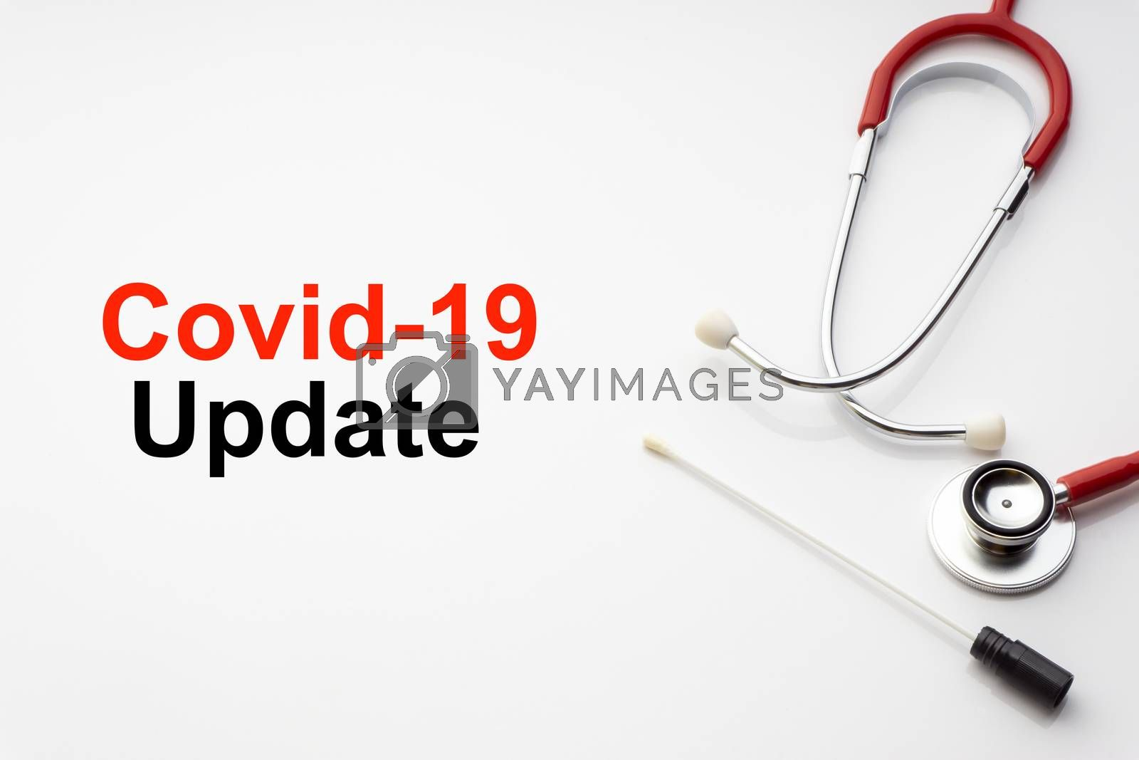 COVID-19 UPDATE text with stethoscope and medical swab on white background. Covid or Coronavirus Concept
