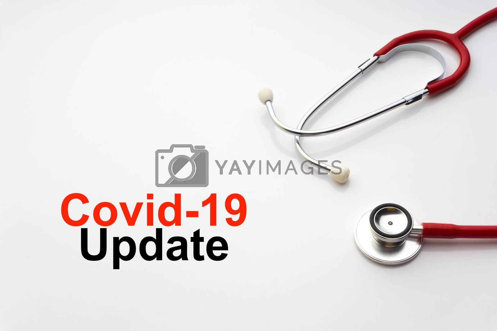 COVID-19 UPDATE text with stethoscope on white background. Covid or Coronavirus Concept
