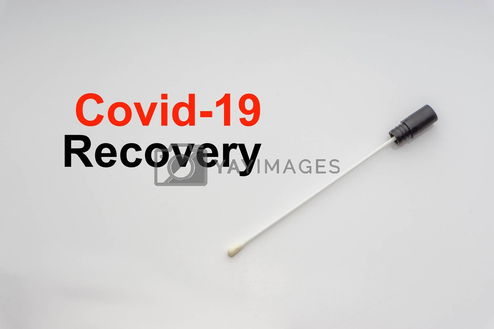 COVID-19 RECOVERY text with medical swab on white background. Covid or Coronavirus Concept