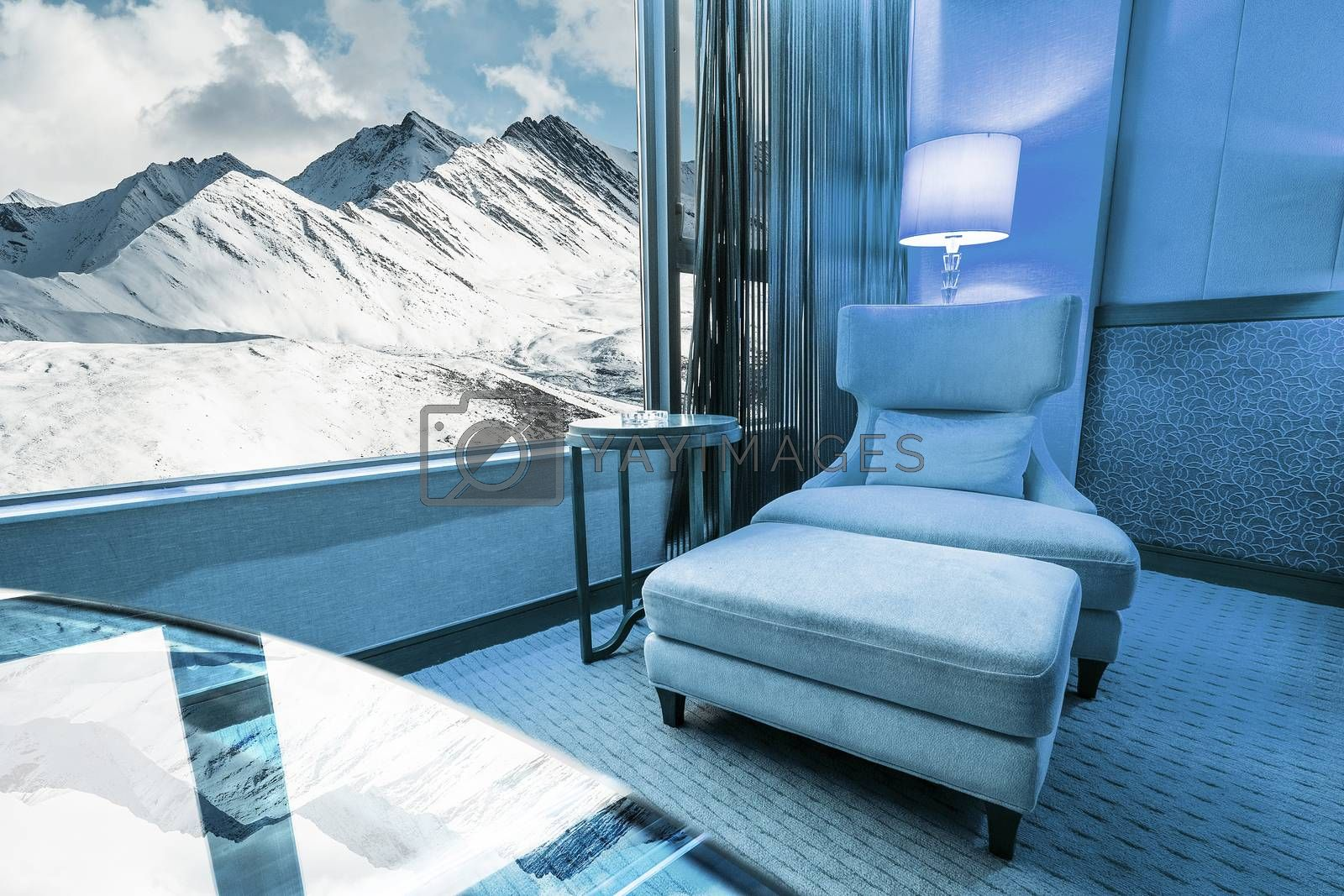 Sofa in living room in Snow Moutain Background