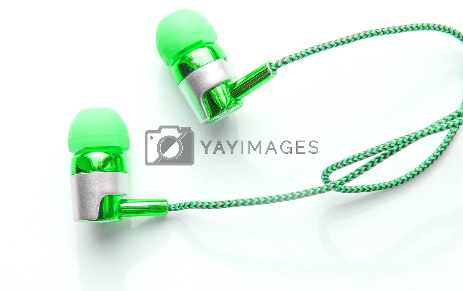 Close-up of green portable headphones for smart work online meetings and conference calls, devices for the phone.