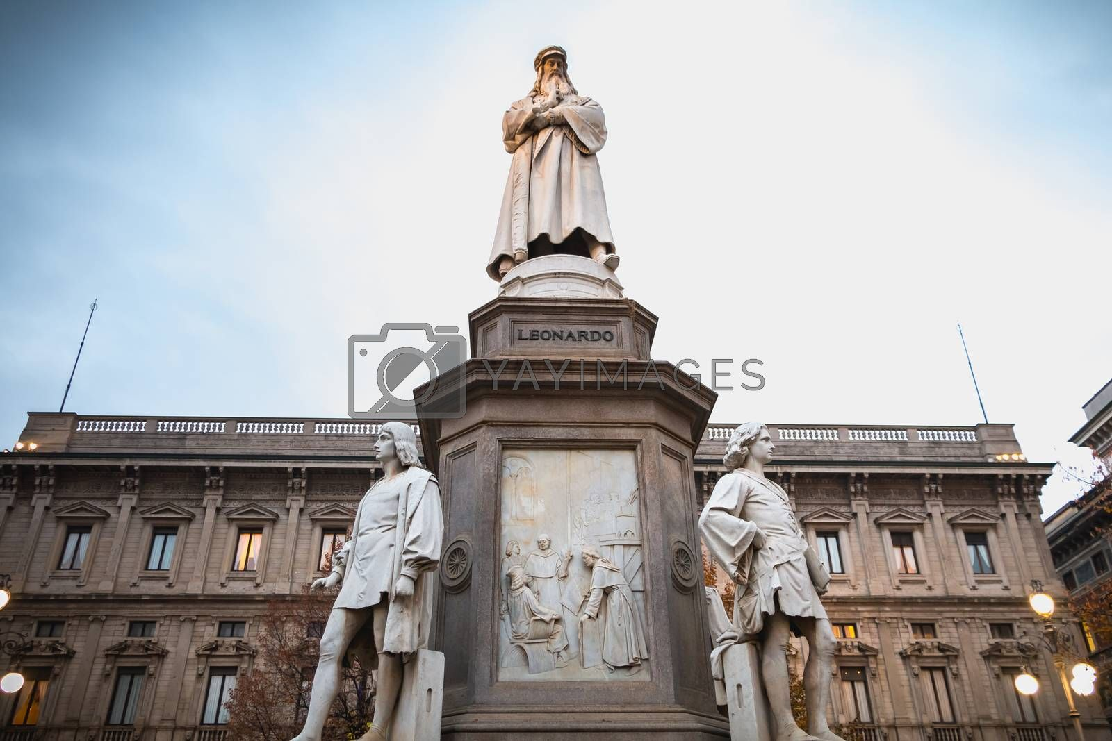 Milan, Italy - November 2, 2017: Architectural detail of a statue to the glory of Leonardo da Vinci by sculptor Pietro Magni in 1872 in front of Milan City Hall