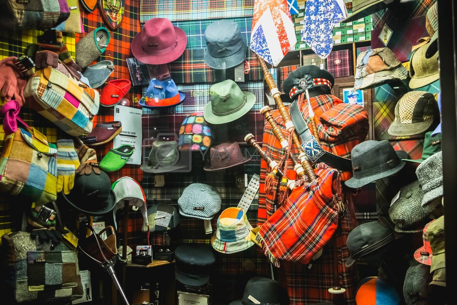 Milan, Italy - November 2, 2017: Showcase of a hat and vintage bag shop in the city center on a fall day