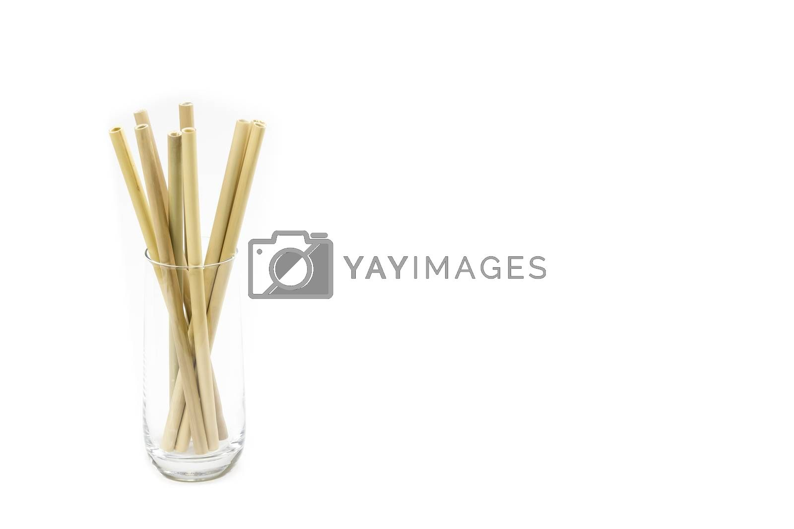Eco-friendly Bamboo drinking straws against white background and large copy space (no to plastic concept)