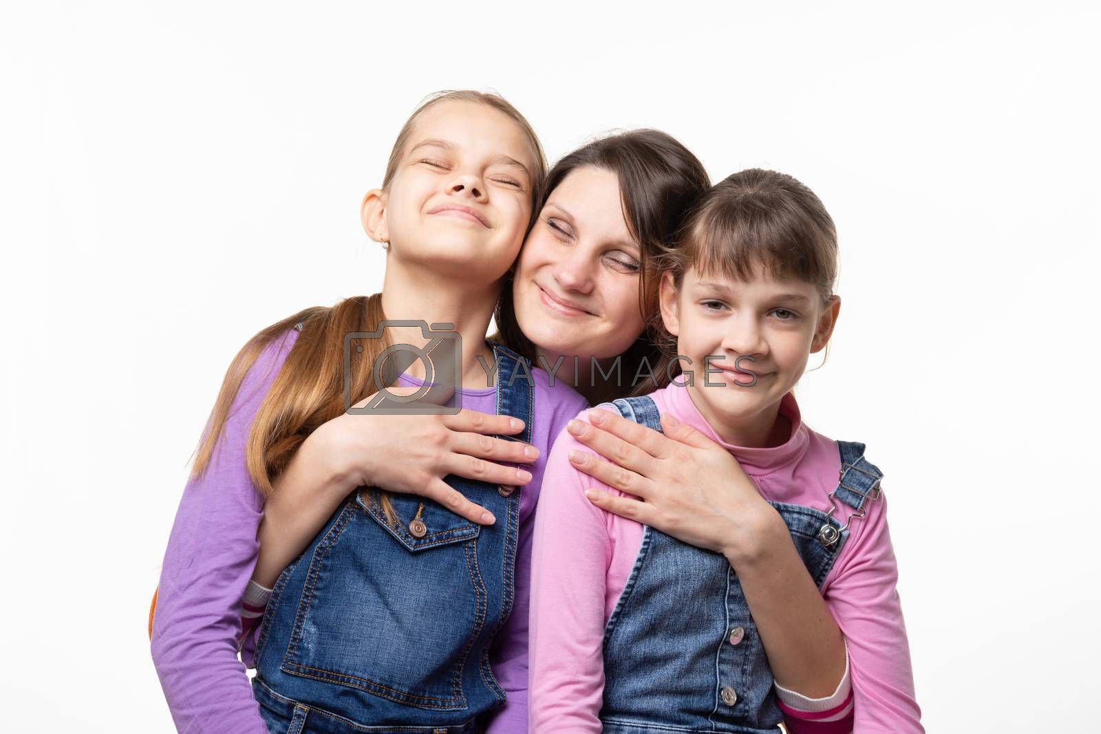 Mom happily clung to her daughters, isolated on white background