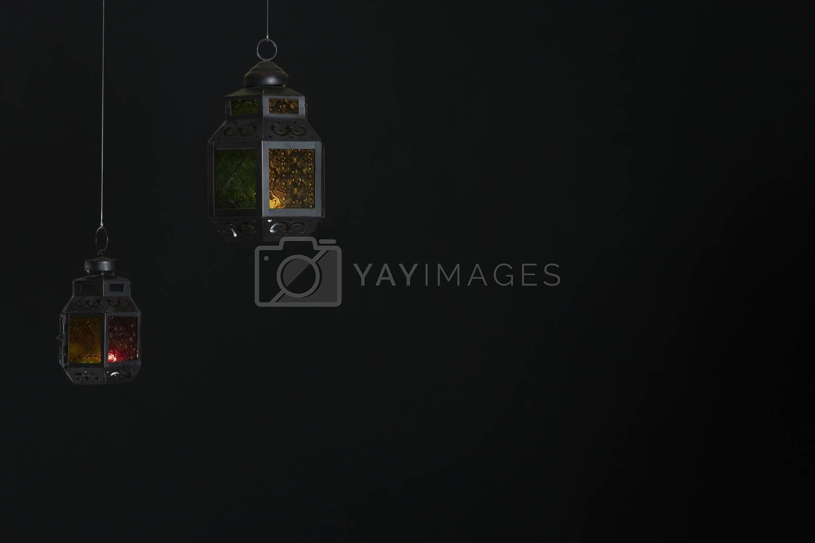 Ramadan oriental  lights lamp decorations light up against black background with copy space