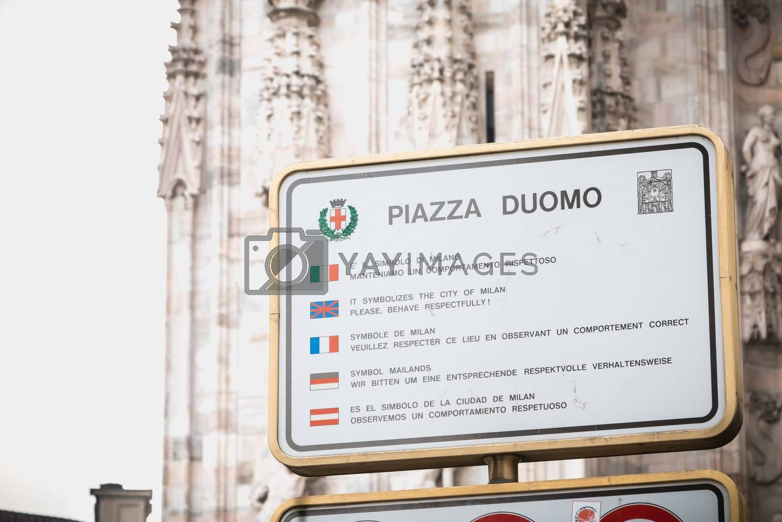 Milan, Italy - November 2, 2017: At the entrance to Duomo Square, a sign asks visitors to respect the place by observing the correct behavior