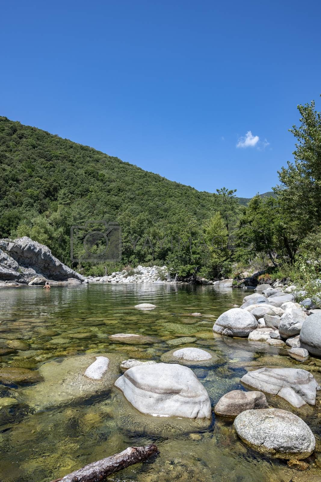 People enjoying in a Pure and fresh water natural pool of Travu River, Corsica, France, Europe (copy space in the sky)