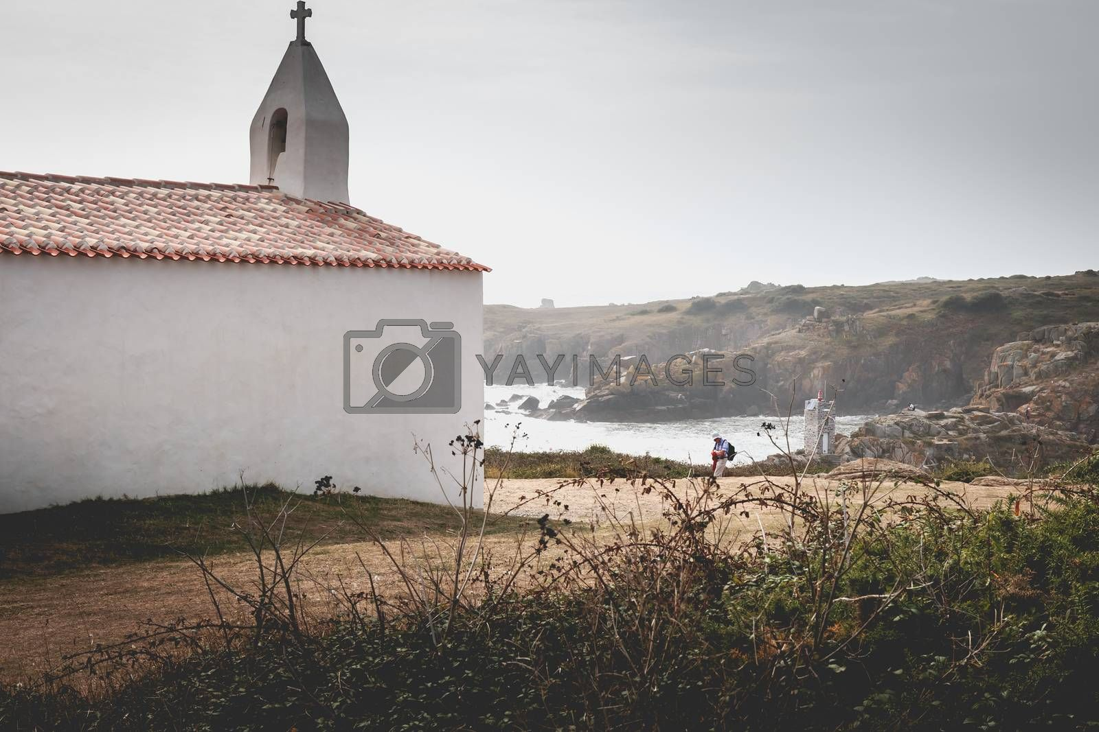 Tourists visiting the surroundings of La Meule chapel near islan by AtlanticEUROSTOXX