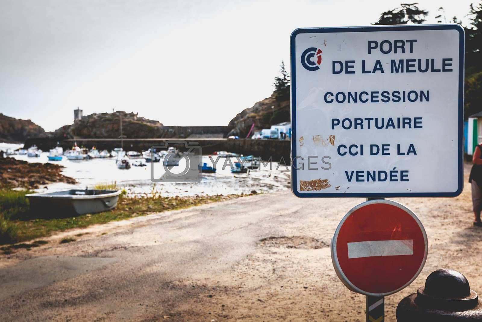 La Meule, France - September 18, 2018: a white sign indicates the entrance of the port of La Meule on the island of Yeu and specifies that it is a port concession of the Vendée CCI