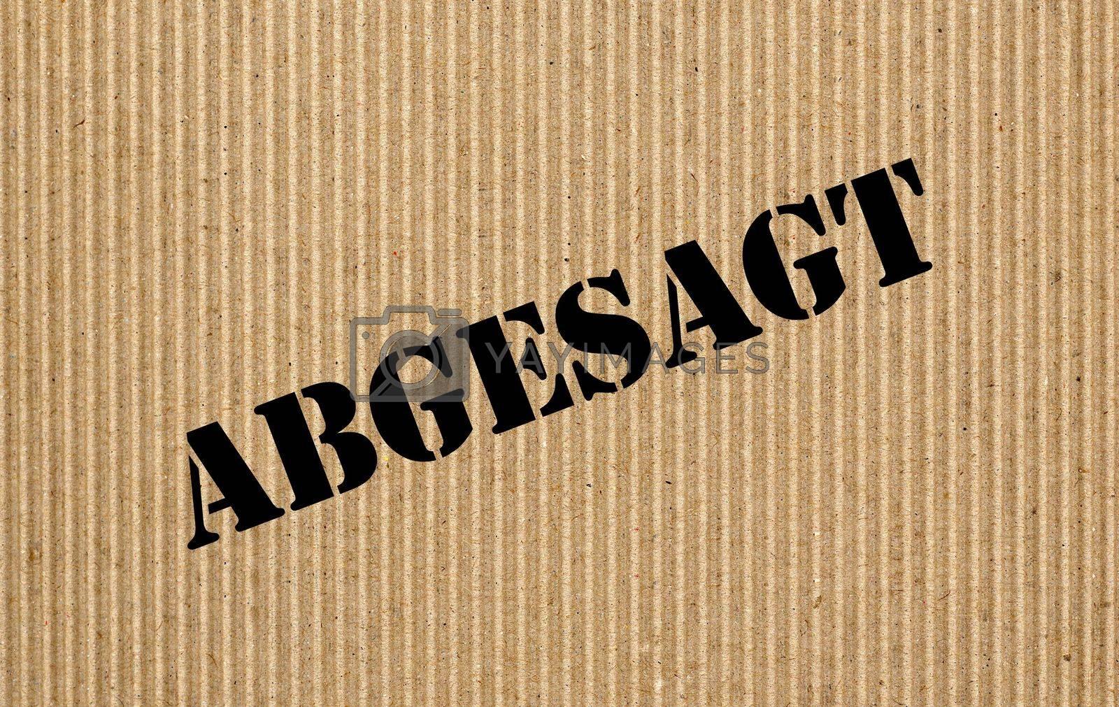 Abgesagt ( translation Cancelled) written on corrugated cardboard