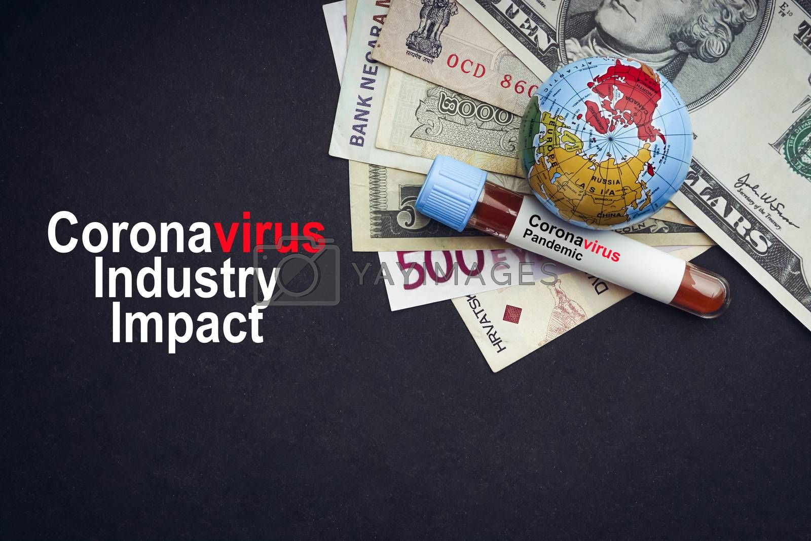 CORONAVIRUS INDUSTRY IMPACT text with currency banknotes, world globe and blood test vacuum tube on black background. Covid-19 or Coronavirus Concept