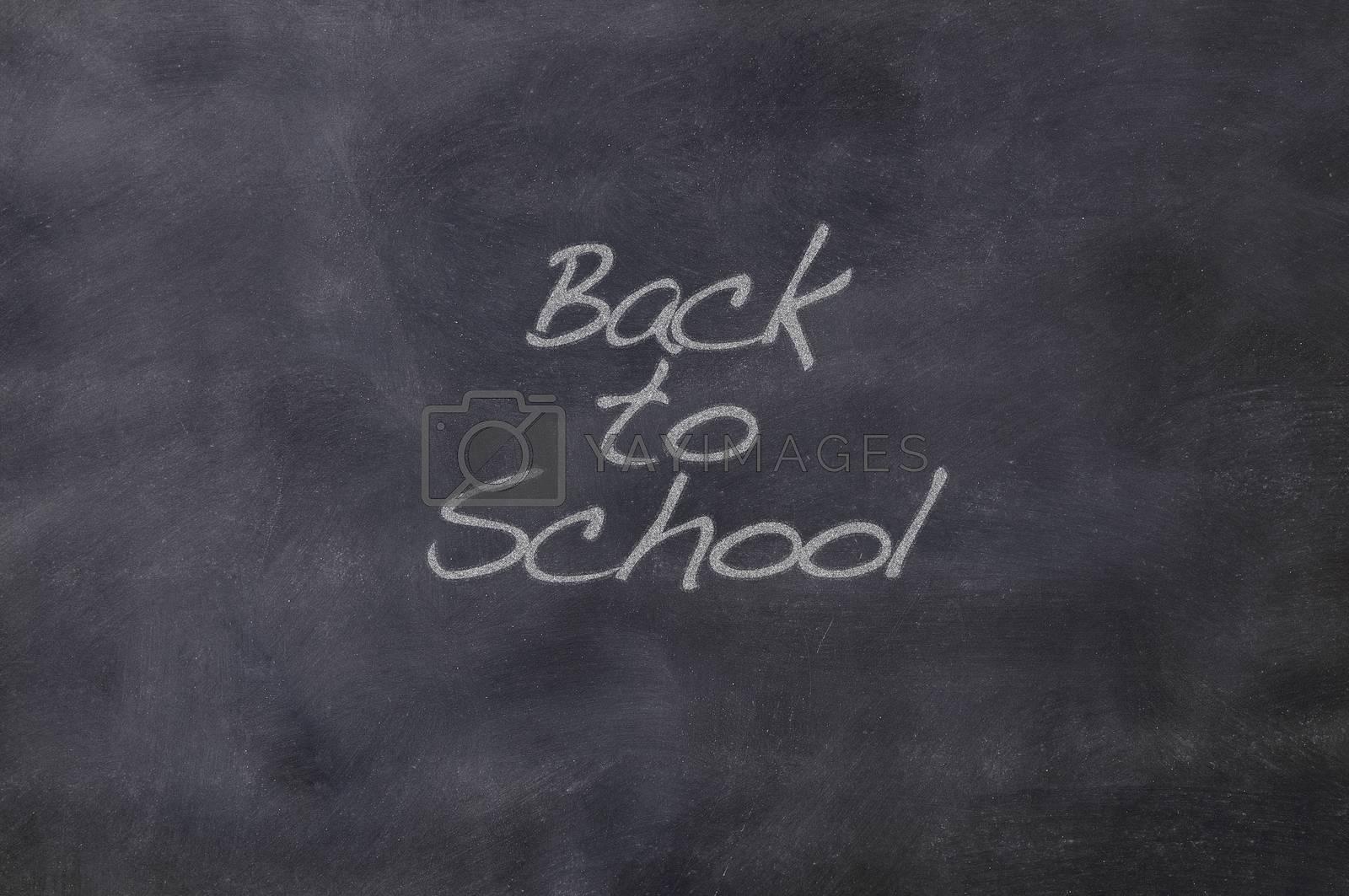 Blackboard school class with the phrase Back to school.