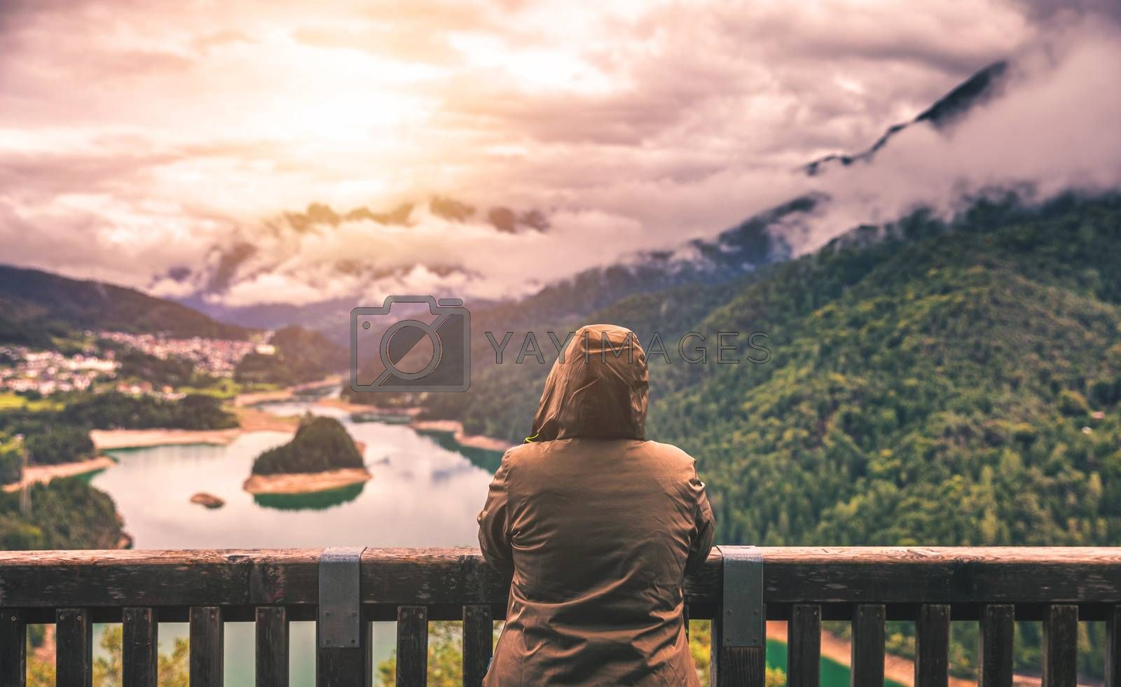 Traveler relaxing meditation with serene view mountains and lake landscape. Travel Lifestyle hiking concept summer vacations outdoor.