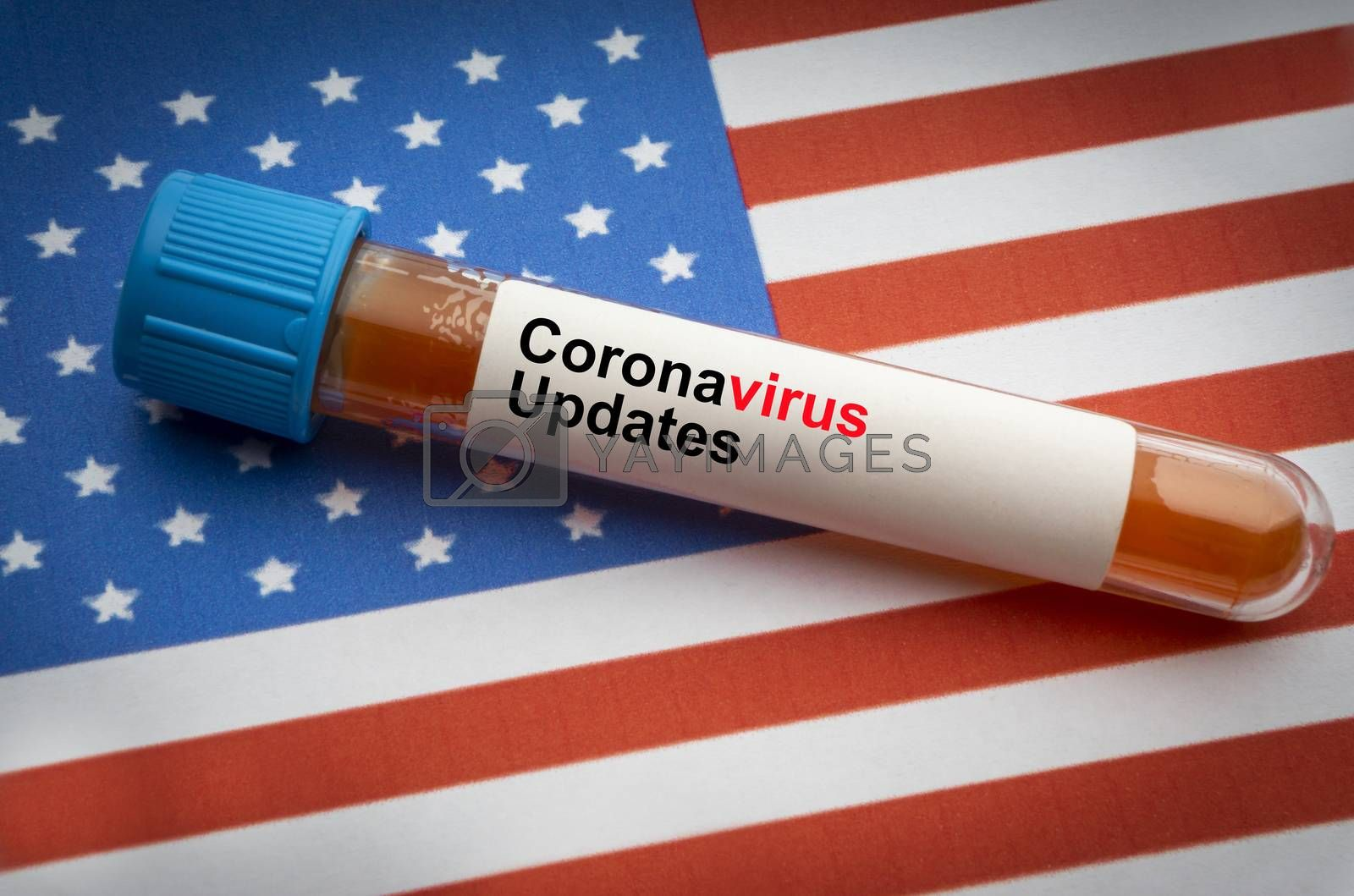 CORONAVIRUS COVID-19 UPDATE text and blood sample vacuum tube on America flags background. Covid-19 or Coronavirus Concept
