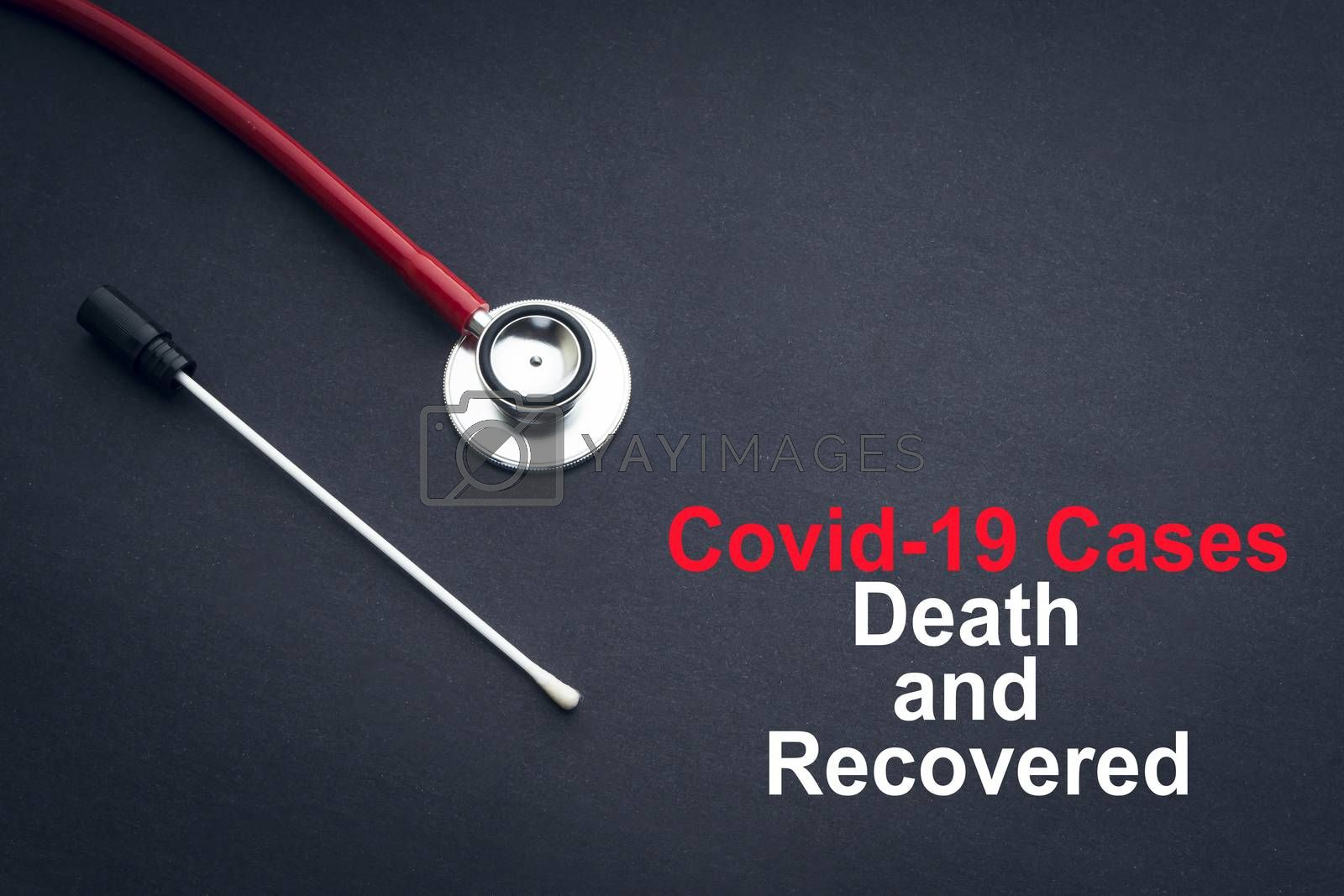 COVID-19 or CORONAVIRUS DEATH AND RECOVERED text with stethoscope and medical swab on black background. Covid-19 or Coronavirus concept.