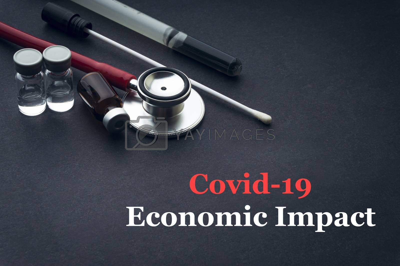 COVID-19 or CORONAVIRUS ECONOMIC IMPACT text with stethoscope, medical swab and vial on black background. Covid-19 or Coronavirus concept.