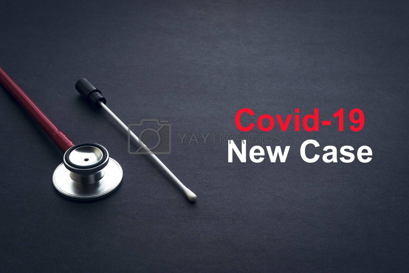 COVID-19 or CORONAVIRUS NEW CASE text with stethoscope and medical swab on black background. Covid-19 or Coronavirus concept.