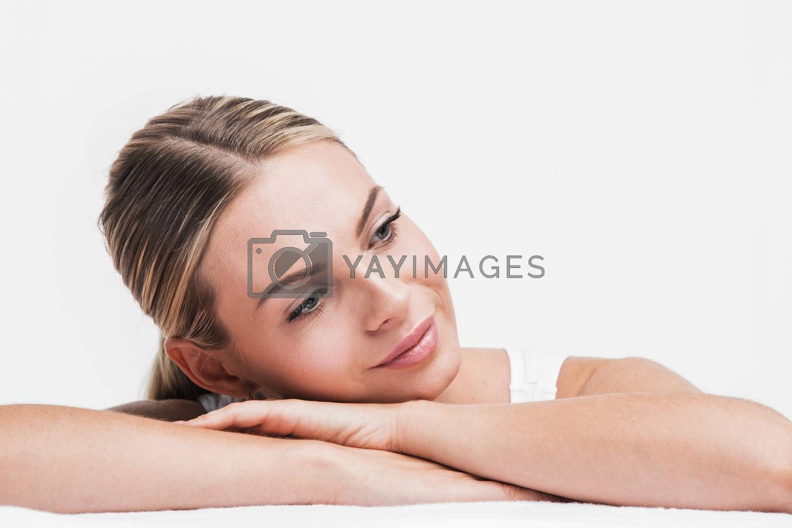 Beautiful face skincare beauty woman lying down on arms isolated on white background