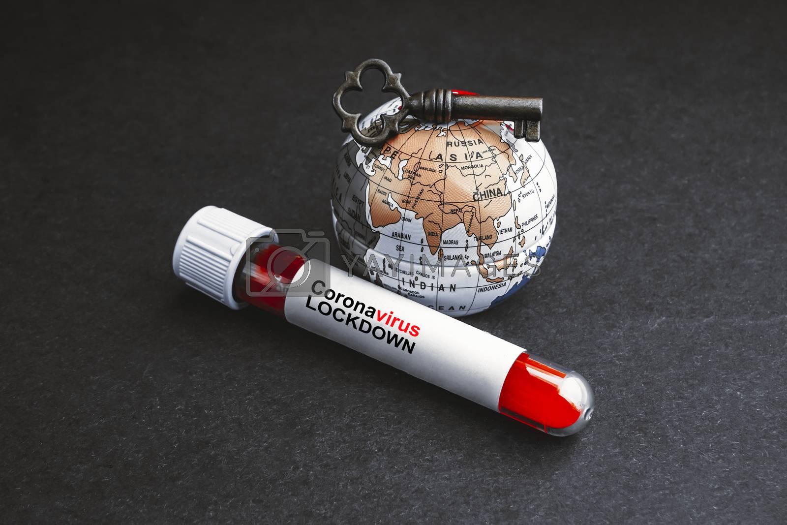 CORONAVIRUS LOCKDOWN text with world globe, key and Blood test vacuum tube on black background. Covid-19 or Coronavirus Concept