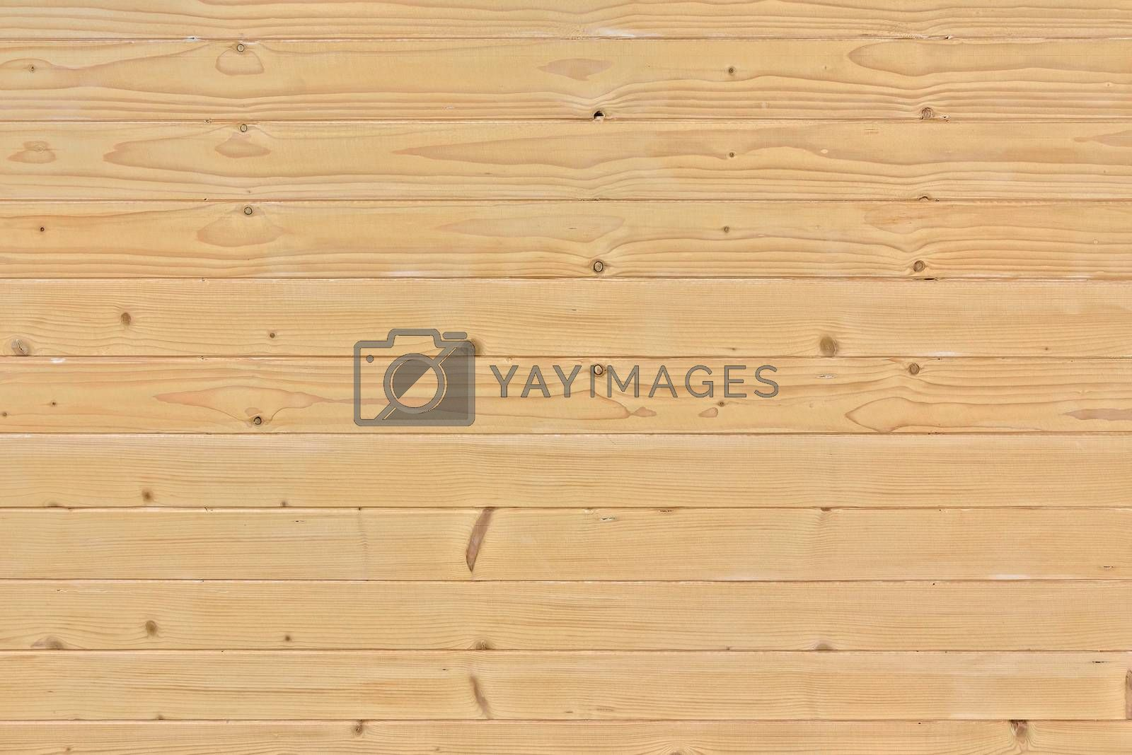 Background or texture made of raw wooden slats