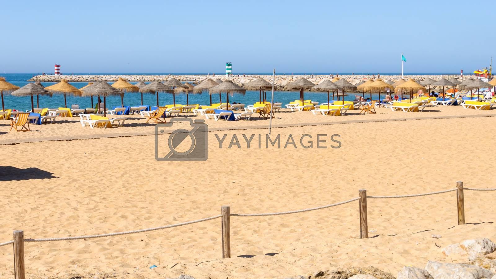 Sandy beach at Atlantic Ocean in Vilamoura, Algarve, Portugal