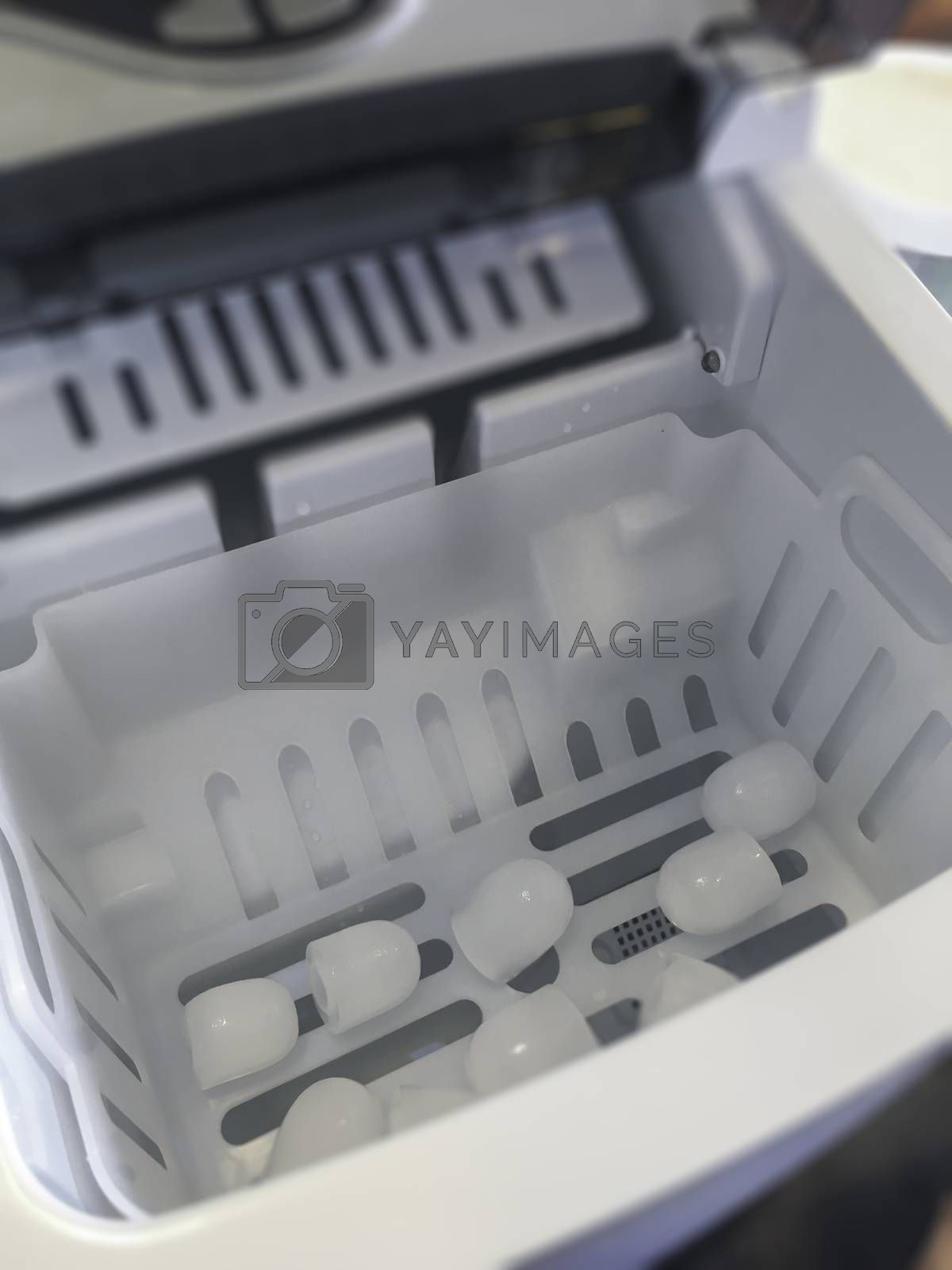 Clean ice cubes from automatic ice maker, stock photo