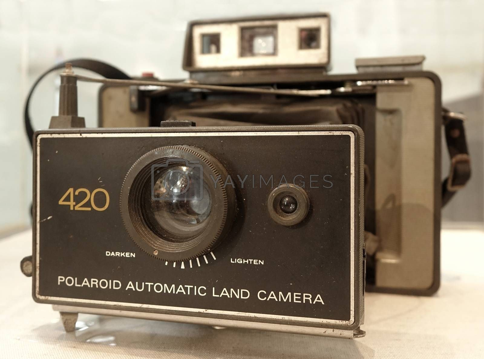 KAOHSIUNG, TAIWAN -- APRIL 10, 2014: This vintage Polaroid Land camera of the 400 series dates back to about 1970. It features a plastic lens and uses instant film.