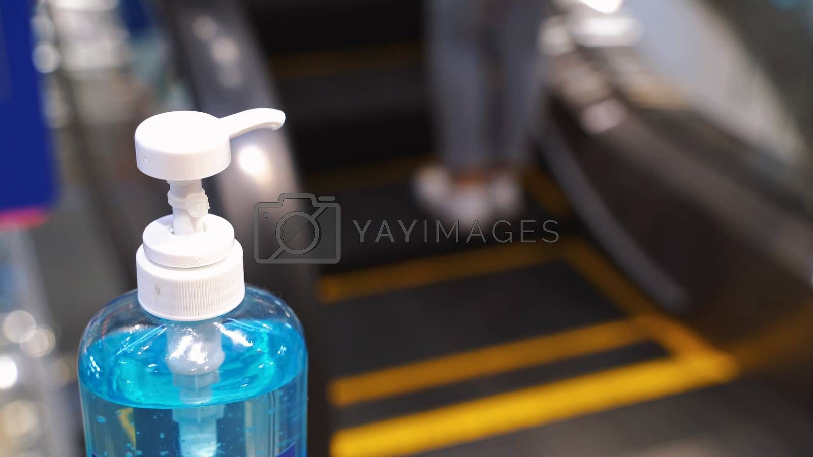 Close up alcohol gel sanitizer at the escalator for prevent the spread of pandemic Covid-19 and Coronavirus, healthcare and hygiene concept