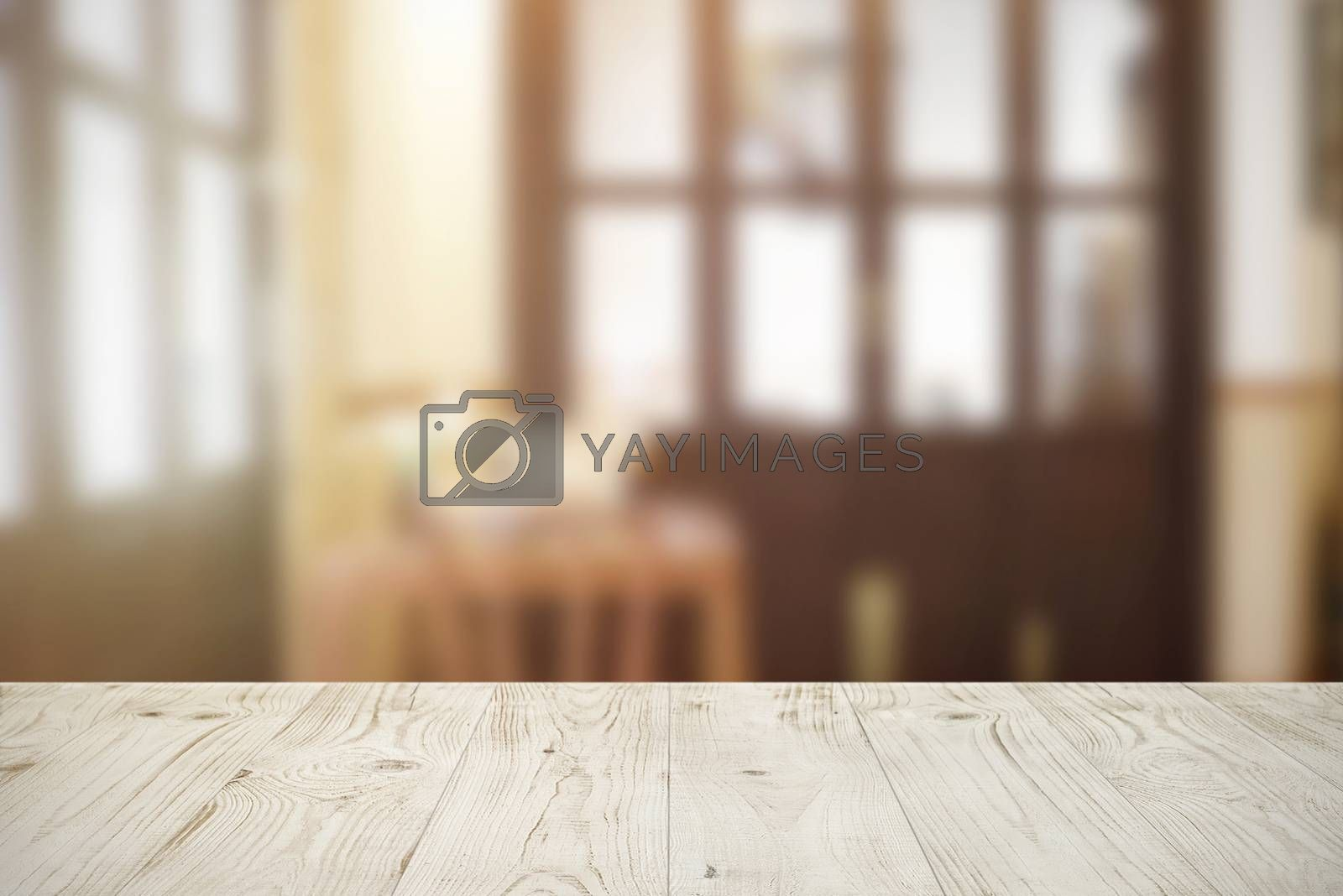Empty wooden board table top on blur abstract of cafe or restaurant background, for montage product or display, mock up for display of product