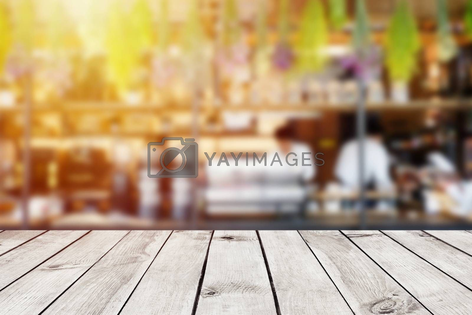 Empty wood table top on blur abstract of cafe or restaurant background, for montage product display