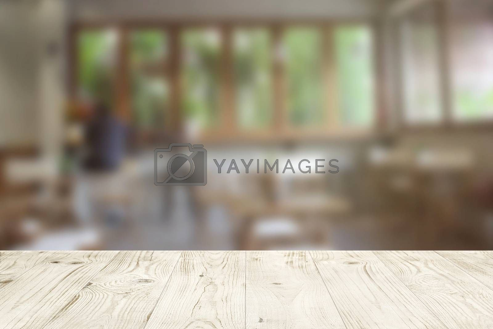 Empty wood table top on blur abstract of cafe or bar background, for montage product display