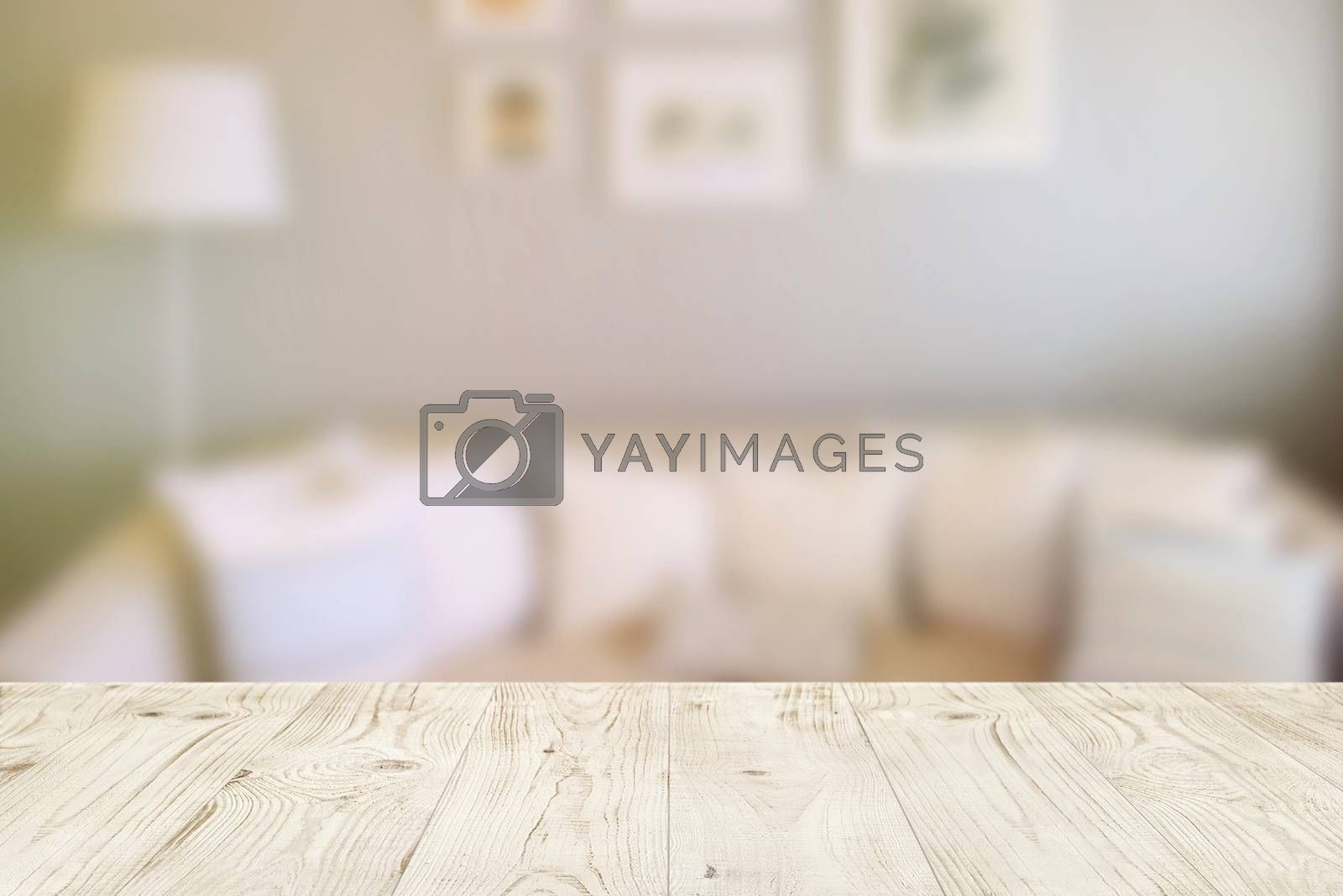 Empty wood table top on blur abstract of interior in living room, for montage product display