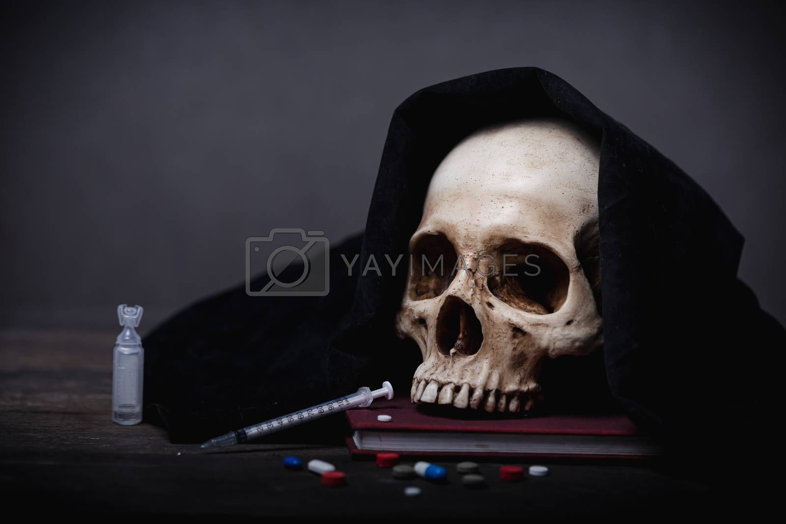 Still life of human skull that died for a long times ,concept of horror or thriller movies of scary crime scene ,The concept of people who die with drugs and Halloween theme, visual art